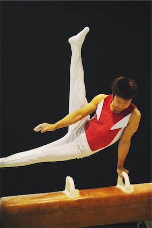 Gymnast performing scissors routine on pommel horse Stock Photo - Rights-Managed, Code: 858-03047727