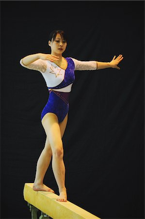 Japanese gymnast performing on balance beam Stock Photo - Rights-Managed, Code: 858-03047738