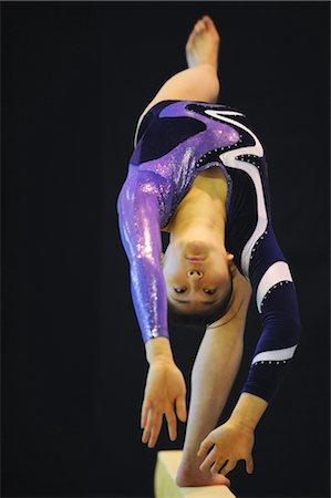 Gymnast doing back flip on balance beam Stock Photo - Rights-Managed, Code: 858-03047741