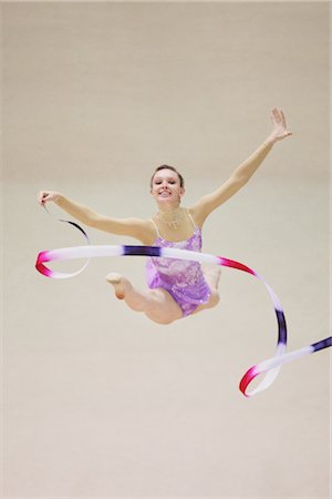 Front view of a young woman performing rhythmic gymnastics with ribbon Stock Photo - Rights-Managed, Code: 858-03048898