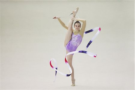 A young woman performing rhythmic gymnastics with ribbon Stock Photo - Rights-Managed, Code: 858-03048914