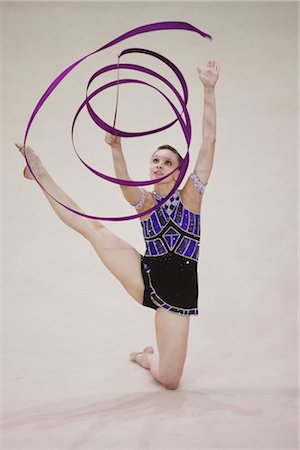 Young woman performing rhythmic gymnastics with ribbon Stock Photo - Rights-Managed, Code: 858-03048917