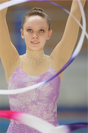 Front view of a young woman performing rhythmic gymnastics with ribbon Stock Photo - Rights-Managed, Code: 858-03048919