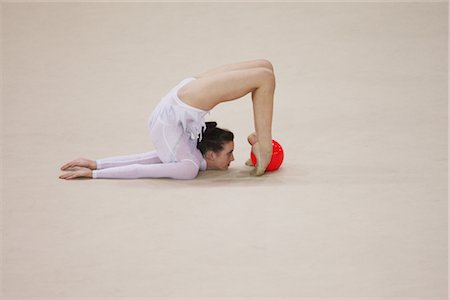 Young woman performing rhythmic gymnastics with ball Stock Photo - Rights-Managed, Code: 858-03048925