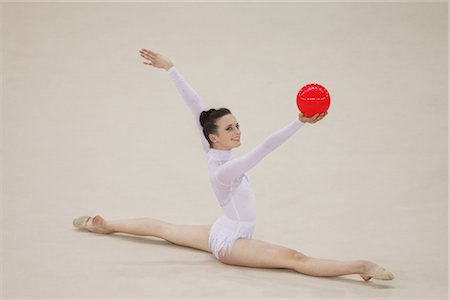 Side view of a young woman doing routine with ball Stock Photo - Rights-Managed, Code: 858-03048927