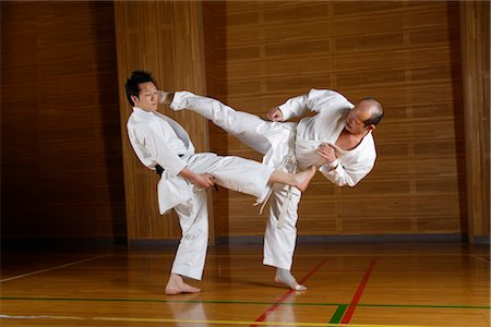 enemy - Two karate fighters kicking simultaneously Stock Photo - Rights-Managed, Code: 858-03049814