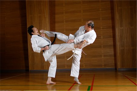 enemy - Two karate fighters kicking simultaneously Stock Photo - Rights-Managed, Code: 858-03049815