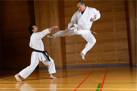 enemy - Two karate contestants sparring,one leaping in air Stock Photo - Rights-Managed, Code: 858-03049816