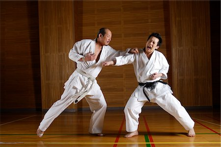 enemy - Two karate contestants sparring Stock Photo - Rights-Managed, Code: 858-03049811