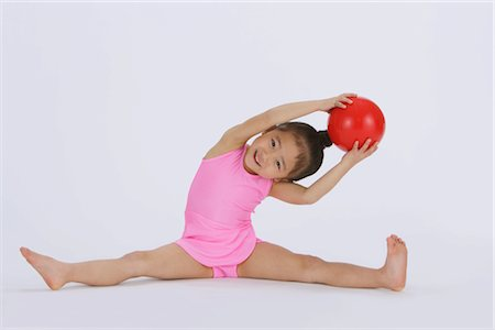 Girl performing rhythmic gymnastic Stock Photo - Rights-Managed, Code: 858-03050018