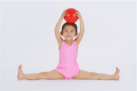 Girl performing rhythmic gymnastic Stock Photo - Rights-Managed, Code: 858-03050019