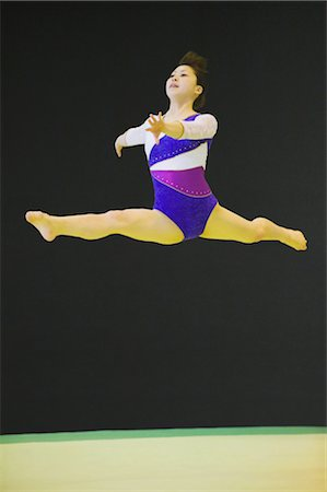 Young woman performing rhythmic gymnastics Stock Photo - Rights-Managed, Code: 858-03050183