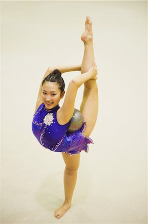 Young woman performing rhythmic gymnastics with ball Stock Photo - Rights-Managed, Code: 858-03050198