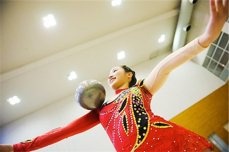 Gymnast performing rhythmic gymnastics with ball Stock Photo - Rights-Managed, Code: 858-03050207