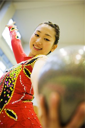 Gymnast performing rhythmic gymnastics with ball Stock Photo - Rights-Managed, Code: 858-03050208