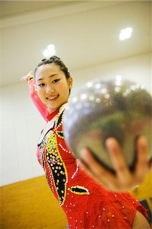 Gymnast performing rhythmic gymnastics with ball Stock Photo - Rights-Managed, Code: 858-03050209