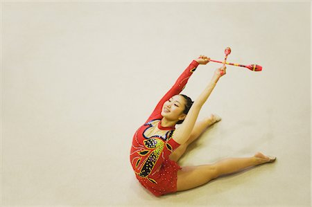 Young woman performing rhythmic gymnastics with clubs Stock Photo - Rights-Managed, Code: 858-03050216