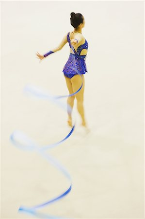 Woman performing rhythmic gymnastics with ribbon Stock Photo - Rights-Managed, Code: 858-03050219