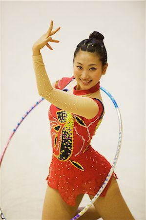 Rhythmic gymnast performing with hoop Stock Photo - Rights-Managed, Code: 858-03050211