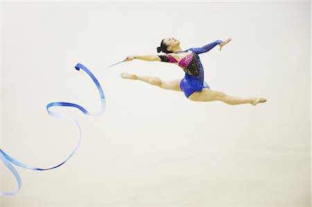 Woman performing rhythmic gymnastics with ribbon Stock Photo - Rights-Managed, Code: 858-03050225
