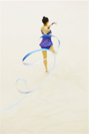 Woman performing rhythmic gymnastics with ribbon Stock Photo - Rights-Managed, Code: 858-03050220