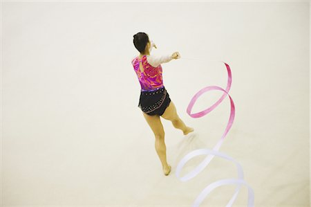 Woman performing rhythmic gymnastics with ribbon Stock Photo - Rights-Managed, Code: 858-03050221