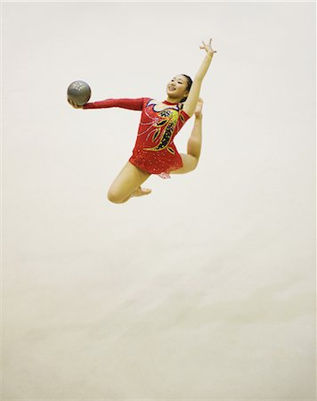 Woman performing rhythmic gymnastics with ball Stock Photo - Rights-Managed, Code: 858-03050222