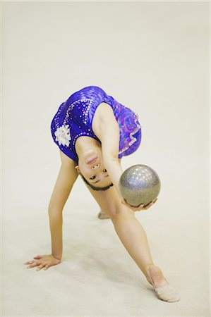 Woman performing rhythmic gymnastics with ball Stock Photo - Rights-Managed, Code: 858-03050233