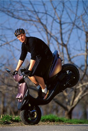 sports scooters - Scooter doing a stunt Stock Photo - Rights-Managed, Code: 858-03053094