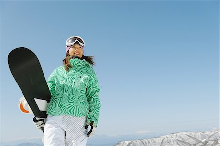 sports and snowboarding - Woman Standing Holding Snowboard Stock Photo - Rights-Managed, Code: 858-03448656