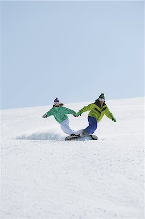 sports and snowboarding - Man and Woman Snowboarding Holding Hands Stock Photo - Rights-Managed, Code: 858-03448658