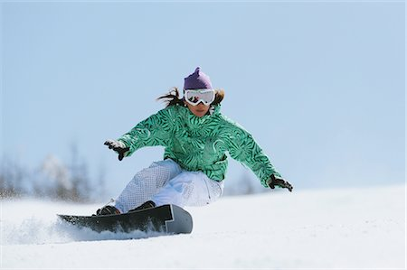 sports and snowboarding - Woman doing Heelside Turn while Snowboarding Stock Photo - Rights-Managed, Code: 858-03448663