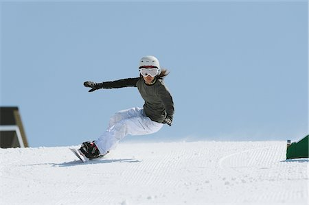 sports and snowboarding - Woman Snowboarding with Arms Outstretched Stock Photo - Rights-Managed, Code: 858-03448672