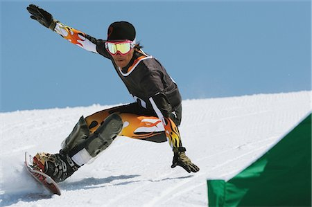 sports and snowboarding - Man Snowboarding at Giant slalom Race Stock Photo - Rights-Managed, Code: 858-03448687