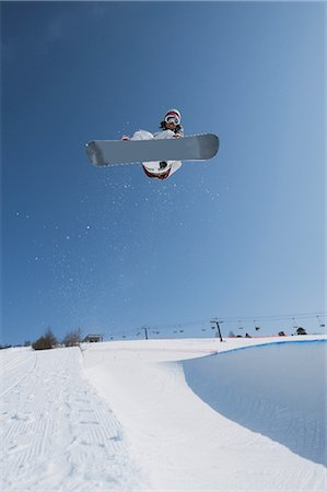 sports and snowboarding - Snowboarder  Jumping  in Mid-air Stock Photo - Rights-Managed, Code: 858-03448699