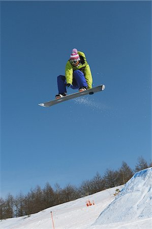 sports and snowboarding - Snowboarder  Jumping  in Mid-air Stock Photo - Rights-Managed, Code: 858-03448701