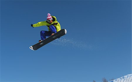 sports and snowboarding - Snowboarder  Jumping  in Mid-air Stock Photo - Rights-Managed, Code: 858-03448702