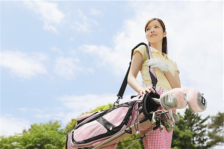 Woman Carrying Golf Bag Stock Photo - Rights-Managed, Code: 858-03694192