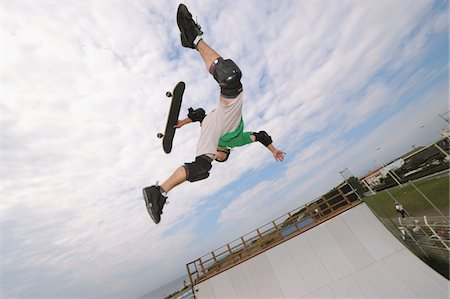 Skateboarder in mid-air Stock Photo - Rights-Managed, Code: 858-03799615