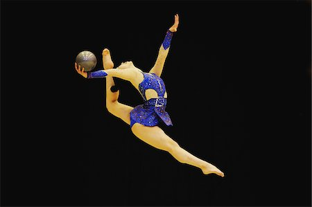 Rhythmic gymnast performing with  ball Stock Photo - Rights-Managed, Code: 858-03799629