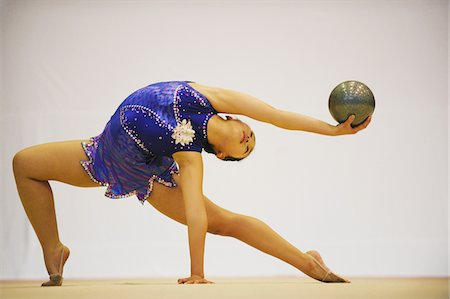 Young woman performing gymnastic Stock Photo - Rights-Managed, Code: 858-03799638