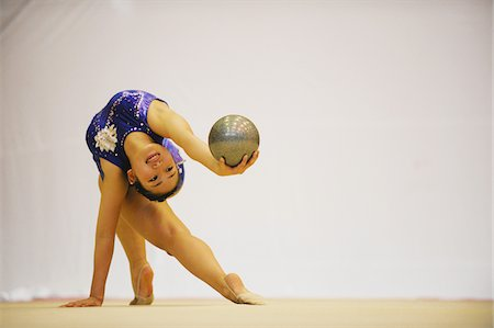 Woman performing gymnastic Stock Photo - Rights-Managed, Code: 858-03799639