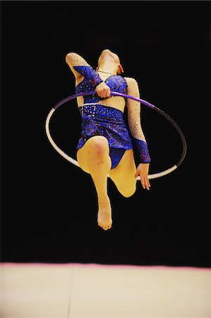 Gymnast in mid-air performing with hoop Stock Photo - Rights-Managed, Code: 858-03799630