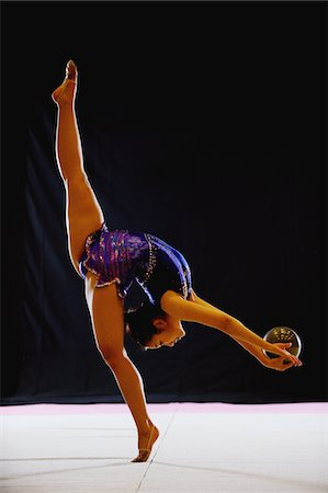 Young acrobat performing with ball Stock Photo - Rights-Managed, Code: 858-03799647