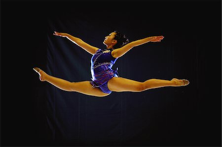 Young adult gymnast performing Stock Photo - Rights-Managed, Code: 858-03799642