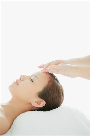 Japanese woman receiving an head massage Stock Photo - Rights-Managed, Code: 859-06404805