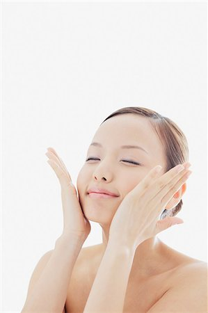 Portrait of a Japanese woman holding her face with both hands Stock Photo - Rights-Managed, Code: 859-06404800