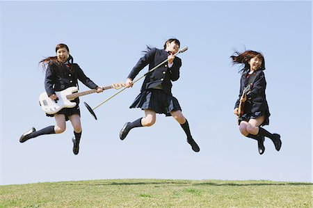 Japanese schoolgirls with musical instruments jumping Stock Photo - Rights-Managed, Code: 859-06404861