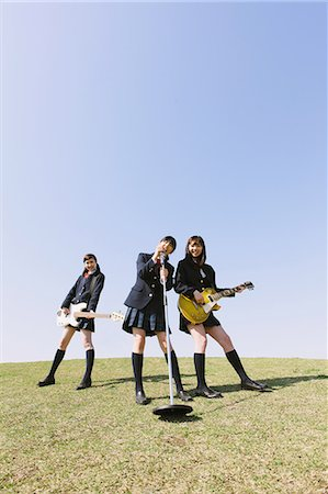 Japanese schoolgirls with musical instruments on a hill Stock Photo - Rights-Managed, Code: 859-06404862