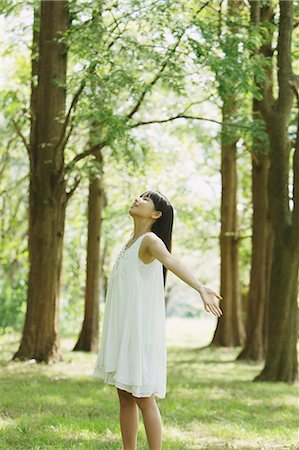 Asian woman in a white dress forest bathing Stock Photo - Rights-Managed, Code: 859-06404912
